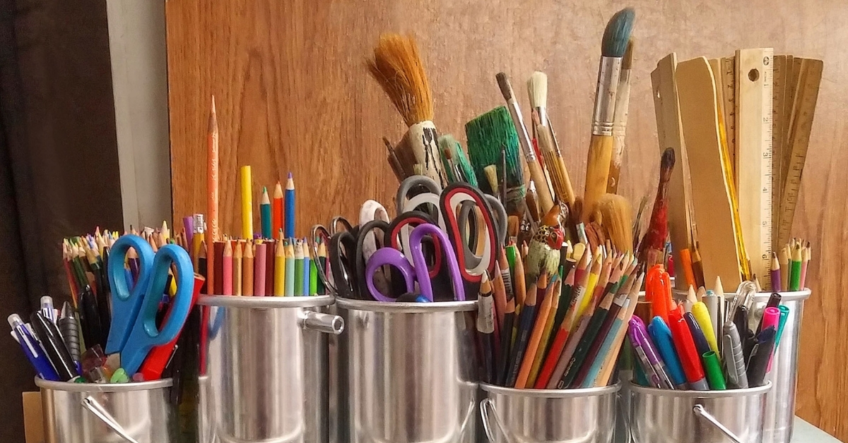 """Image for """"What is Art Therapy?""""IMAGE: Pots of paint brushes, colouring pencils and art supplies."""